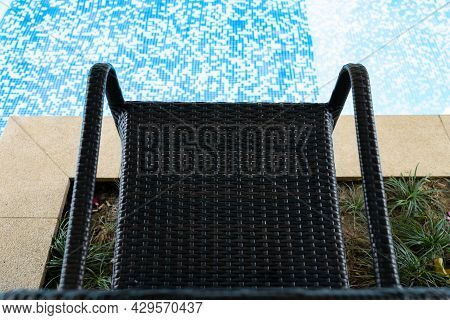 Seat On The Edge Of A Swimming Pool