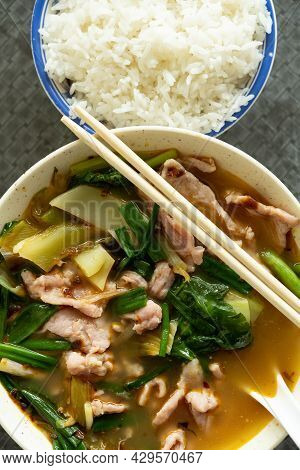 Top View Fast Food Of Spicy Boiled Pork With Rice Vertical Composition