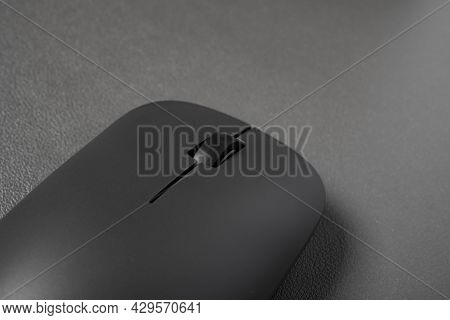Black Wireless Mouse Close Up On A Dark Background