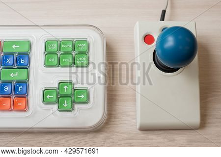 Close-up Of A Specialized Computer Mouse And Keyboard For People With Cerebral Palsy.