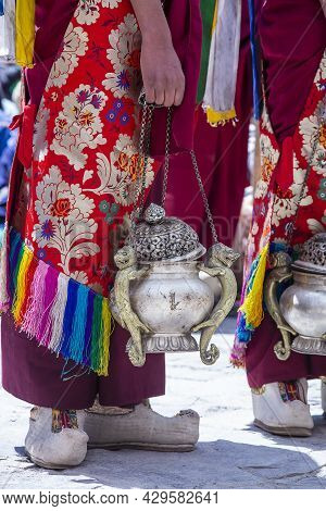 Tibetan Monk Holds A Censer, A Metal Vessel For Smoking Incense, During Worship At A Buddhist Festiv