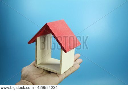 Concept On Hand There Is A Red Roof House