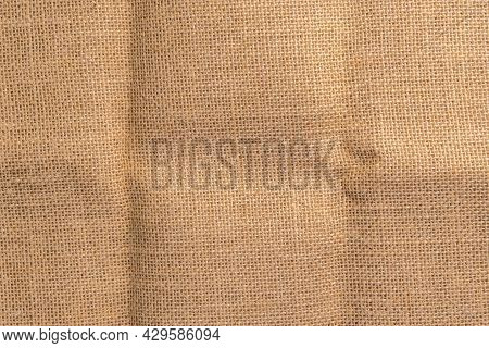 Rough Rustic Sackcloth Texture Crumpled Background. Copy Space. Folded Creased Natural Material. Abs