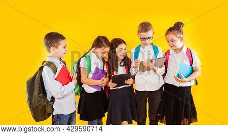 Group Of Classmates Reading Books And Ebooks