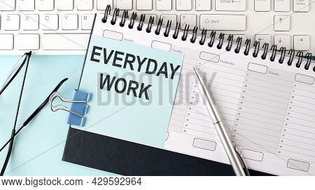 Everyday Work Text On Blue Sticker On The Planning And Keyboard,blue Background
