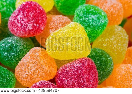 Close Up View Of Delicious Multicolored Jelly Sugar Candies. Orange, Yellow, Red And Green Jelly Sug