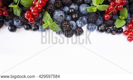 Ripe Raspberries, Blueberries, Blackberries, Red And Blackcurrants On White Background. Background O