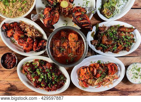 Assorted Indian Foods Chicken Pahadi Kebab,chicken Angara Kebab,tandoori Chicken,pepper Chicken, Pan