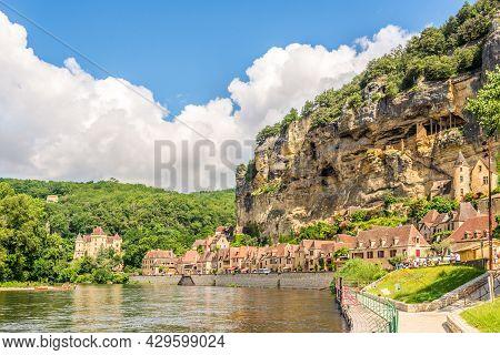 La Roque Cageac, France - June 25,2021 - View At The La Roque-gageac Village With River Dordogne. La