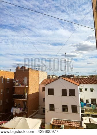 Views Of Different Colored Buildings In The Community Of Madrid, In Spain. Sky With Tall Clouds Deco