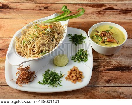 Khow Suey - Burmese Curried Noodle Soup Made Of Noodles And Curried Beef Or Chicken With Coconut Mil