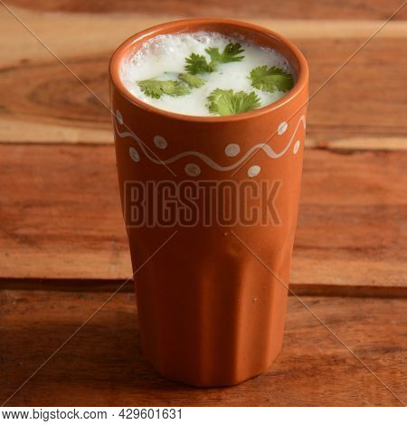 Summer Cooler Buttermilk Drink. Made Of Yogurt. Served In A Traditional Clay Pot, Selective Focus On
