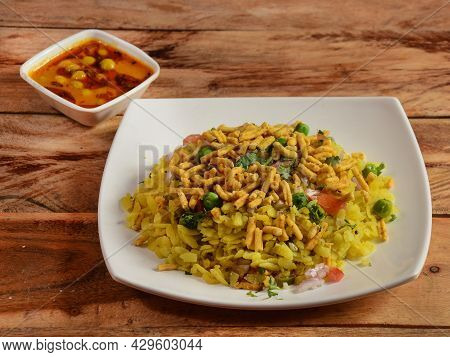 Usal Poha, Made With Flattened Rice, Typically Western Indian Breakfast, Served With Gravy Over A Ru
