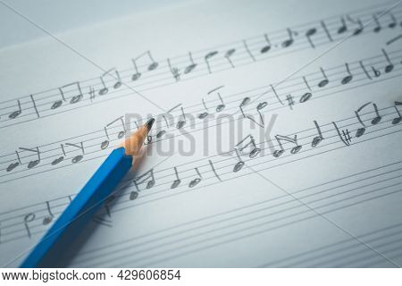 Random music notes with pencil. Music and compose concept.