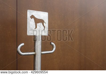 Close-up Of An Outdoor Dog Parking Sign. A Place For A Leash For Dogs Waiting For Their Owners On Th