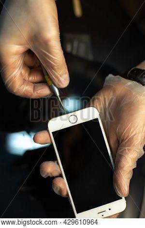 Minsk. Belarus 27.01.2018 - Apple Mobile Device Repair. Phone In Hands Of The Master.