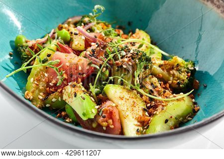 Healthy avocado and tomato salad bowl. Green Salad made from avocado, tomato slice and edamame beans.  Healthy meal isolated on white background. Healthy vegan salad bowl.