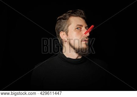 Bearded Man With Clothespin On Nose. Bad Stink, Funny Prankster, Joke Concept. Laugh At Yourself. Re