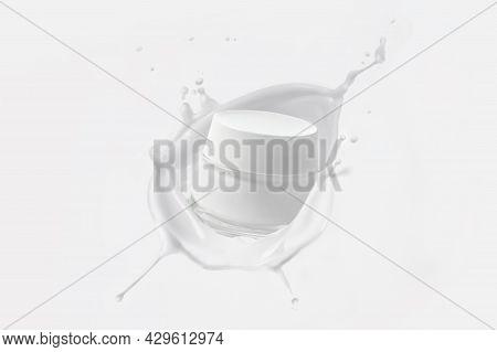 A Jar Of Skin Cream In A White Milk Splash. Splash Of Cream On A White Background. Milk Splash. Whit