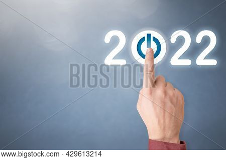 Finger Pressing Blue Start 2022 Button On Virtual Interface On Gray Background With Copy Space For T