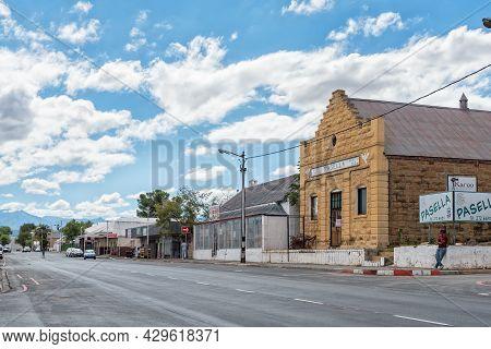 Oudtshoorn, South Africa - April 5, 2021: A Street Scene, With Businesses, In Oudtshoorn In The West