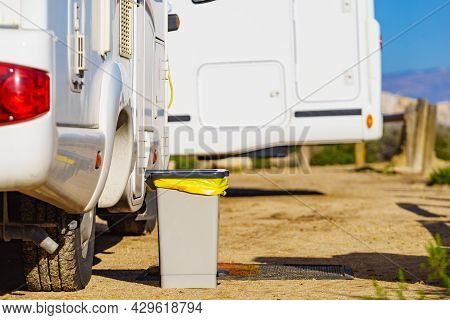 Trash Can With Plastic Bag Inside In Front Of Caravan. Holidays And Travel In Motorhome.