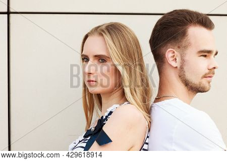 Young Couple Not Talking To Each Other, Standing Back To Back After Argument Quarrel. Disagreement I