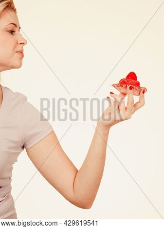 Diet, Sweets, Food Concept. Cute Blonde Attractive Woman About To Eat Delicious Sweet Strawberry Cup