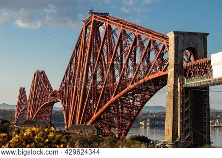 The Forth Rail Bridge Dominates The Landscape Above North Queensferry As It Marches Over The River F