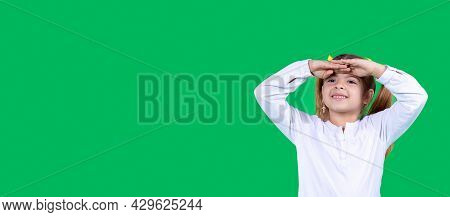 Young Girl Girl In White T-shirt Posing Isolated In Studio Holding Hand At Forehead Looking Far Away