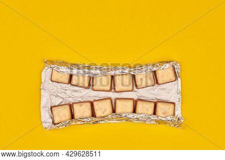 Kaliningrad, Russia - 03.27.2021 - Schogetten Chocolate In Foil As Dental Teeth Concept. Delicious G