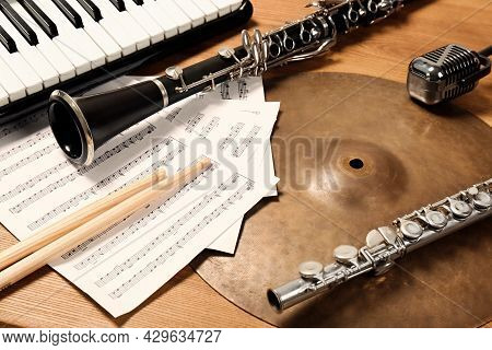 Set Of Different Musical Instruments On Wooden Background, Closeup