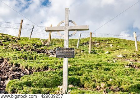 An Port, County Donegal, Ireland - August 11 2021 : Cross Standing At The Harbour
