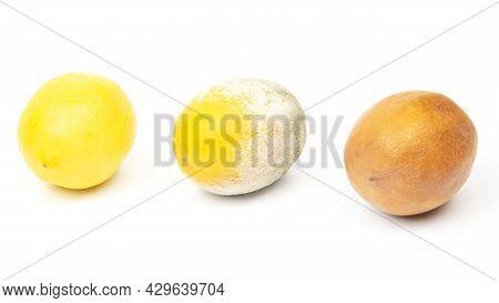 Rotten Lemon Next To Fresh Lemons On A White Background