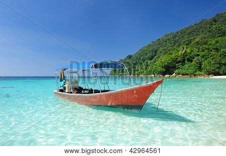 Beautiful beach with motor boat at Perhentian islands, Malaysia