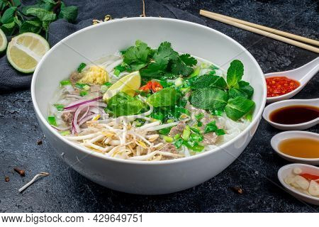 Soup Pho Bo With Beef And Spices On Black Stone Table