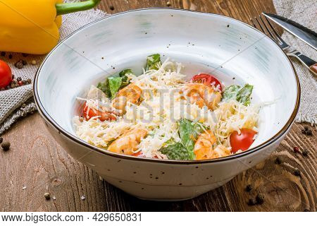 Salad Caesar With Shrimps And Tomatoes On Bowl