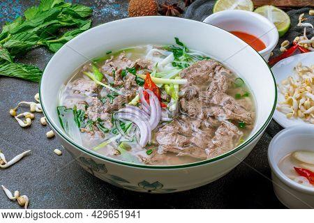 Soup Pho Bo On Dark Stone Table
