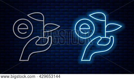 Glowing Neon Line Leaf In Hand Of Environmental Protection Icon Isolated On Brick Wall Background. S