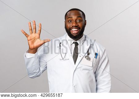 Friendly-looking Cheerful Handsome African-american Doctor, Male Physician Showing Five, Fifth Numbe