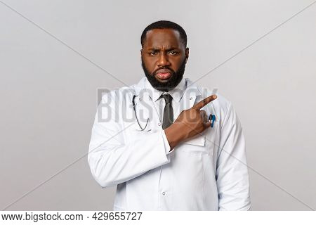 Healthcare, Medicine And Epidemic Concept. Serious-looking Angry And Frustrated African-american Doc