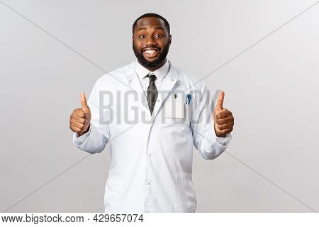 You Are Fine, Just Follow Prescription. Cheerful African-american Male Doctor, Physician Show Thumbs