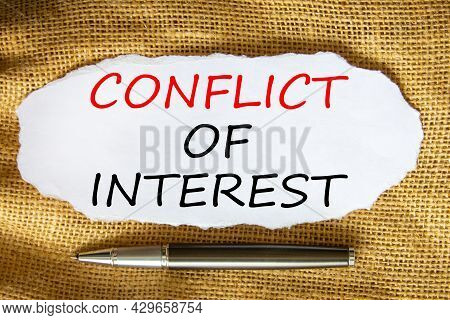 Conflict Of Interest Symbol. Words 'conflict Of Interest' On White Paper. Black Metallic Pen. Beauti