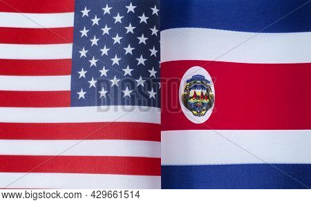 Fragments Of The National Flags Of The United States And Costa Rica In Close-up