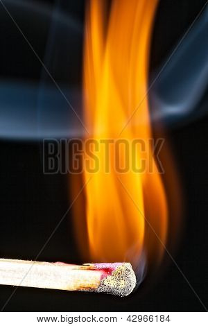 Match with smoke and fire on black poster