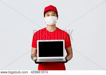 Place Your Order And We Deliver Fast. Smiling Asian Delivery Guy Showing Online Shopping Site For Cl