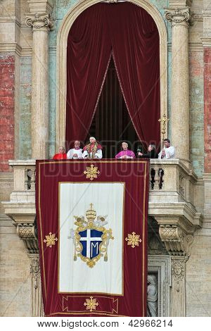 VATICAN - APRIL 19: Pope Benedict XVI (Joseph Ratzinger) on the balcony of Saint Peter's Basilica after he was elected by conclave as pope prays and blesses in Vatican city, Vatican on April 19, 2005.