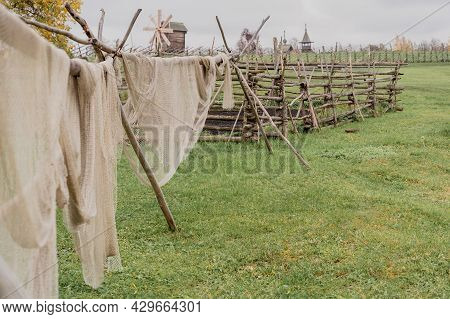Fishing Net On The Shore And Site Of Old Wooden Church And Windmill. Beautiful Rustic Background.