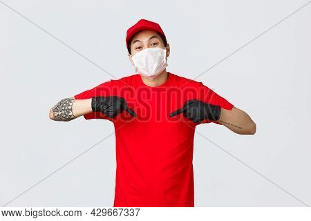 In Time Delivery With This Company Couriers Service. Cheerful Asian Courier In Cap And Red T-shirt,