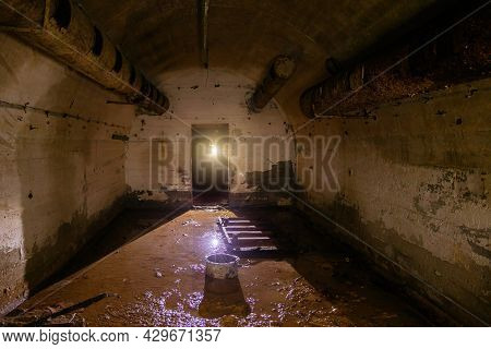 Flooded Round Abandoned Bunker With Water Reflection